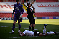 24th April 2021; The Valley, London, England; English Football League One Football, Charlton Athletic versus Peterborough United; Peterborough keeper Josef Bursik, on loan from Stoke, watches as the referee calls for medical assistance on defender Nathan Thompson