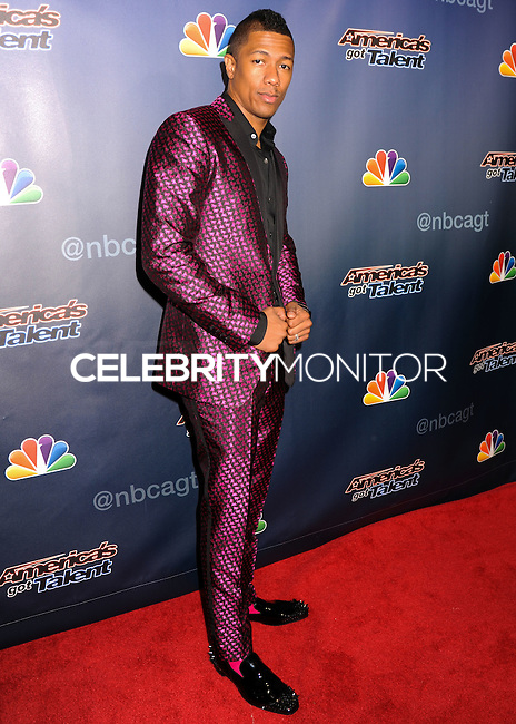 NEW YORK CITY, NY, USA - AUGUST 13: Nick Cannon arrives at the 'America's Got Talent' Season 9 Post Show Red Carpet held at Radio City Music Hall on August 13, 2014 in New York City, New York, United States. (Photo by Celebrity Monitor)