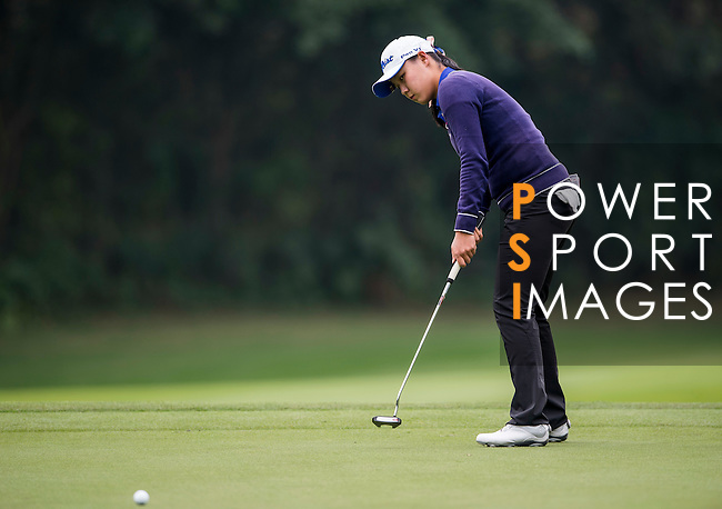 Ziyi Wang of China putts during the Hyundai China Ladies Open 2014 on December 12 2014 at Mission Hills Shenzhen, in Shenzhen, China. Photo by Li Man Yuen / Power Sport Images