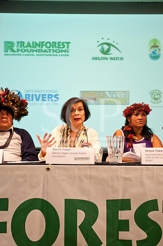 London, England. Chief Almir Surui, Bianca Jagger and Sheyla Juruna during the visit of Sheyla Yakarepi Juruna, Chief Almir Narayamoga Surui and Ruth Buendia Mestoquiari Ashaninka to London to highlight the impact of hydroelectric dams proposed for the rivers of the Amazon basin,