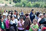 Residents in San Jose El Recreo, San Marcos, a 7.4 earthquake struck Guatemala Wednesday Nov. 7. awaits emergency food relief.