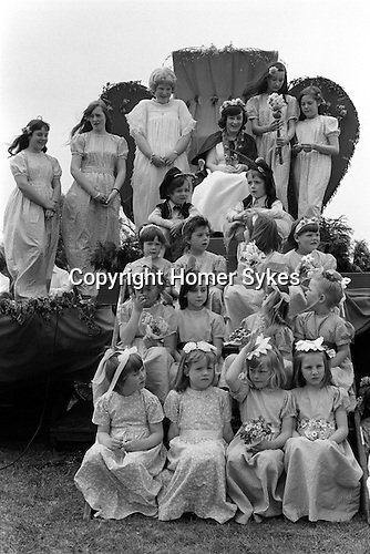 Ickwell Bedfordshire Annual May Queen ( Miss Shirley Fraser.Tableau, with the last years May Queen dressed in white next to this years May Queen 1970s England