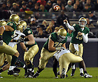 Nov. 20, 2010; Quarterback Tommy Rees throws against Army at Yankee Stadium. ..Photo by Matt Cashore/University of Notre Dame