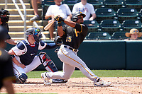 Pittsburgh Pirates outfielder Wilmer Difo (15) bats during a Major League Spring Training game against the Minnesota Twins on March 16, 2021 at Hammond Stadium in Fort Myers, Florida.  Also shown is catcher Mitch Garver.  (Mike Janes/Four Seam Images)