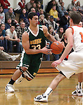 Manogue's Dominick Marazzo looks around Douglas' Connor Hughes during a boys basketball game between Bishop Manogue and Douglas High in Minden, Nev., on Thursday, Dec. 22, 2011..Photo by Cathleen Allison