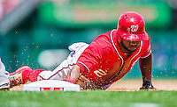 31 May 2014: Washington Nationals outfielder Denard Span slides safely back to first during play against the Texas Rangers at Nationals Park in Washington, DC. The Nationals defeated the Rangers 10-2, notching a second win of their 3-game inter-league series. Mandatory Credit: Ed Wolfstein Photo *** RAW (NEF) Image File Available ***