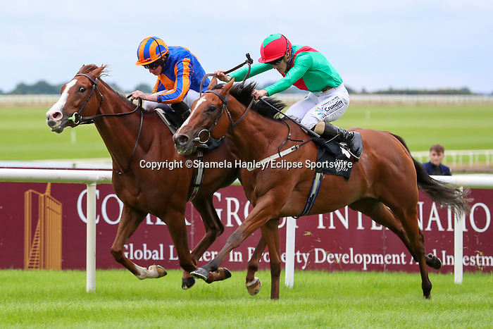 September 12, 2021: La Petite Coco (IRE) #6, ridden by jockey Billy Lee noses out Love (IRE) #1 ridden by jockey Ryan Moore to win the Group 2 Blandford Stakes on the turf on Irish Champions Weekend at Curragh Racecourse in Kildare, Ireland on September 12th, 2021. Shamela Hanley/Eclipse Sportswire/CSM