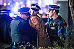 © Joel Goodman - 07973 332324 . 01/01/2016 . Manchester , UK . Police detain a woman . Revellers in Manchester on a New Year night out at the clubs around the city centre's Printworks venue . Photo credit : Joel Goodman