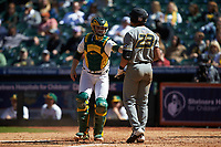 Baylor Bears catcher Andy Thomas (25) tags Austin James (23) of the Missouri Tigers in game one of the 2020 Shriners Hospitals for Children College Classic at Minute Maid Park on February 28, 2020 in Houston, Texas. The Bears defeated the Tigers 4-2. (Brian Westerholt/Four Seam Images)