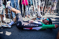 An exhausted stage winner Sonny Colbrelli (ITA/Bahrain - Victorious) collapses behind the finish line after a clearly hard fought victory that also establishes him as the new GC leader<br /> <br /> 17th Benelux Tour 2021<br /> Stage 6 from Ottignies/Louvain-la-Neuve to Houffalize (BEL/208km)<br /> <br /> ©kramon
