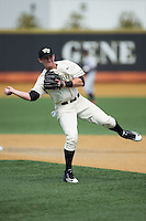 Drew Freedman (5) of the Wake Forest Demon Deacons makes a throw to first base during infield practice prior to the game against the Richmond Spiders at David F. Couch Ballpark on March 6, 2016 in Winston-Salem, North Carolina.  The Demon Deacons defeated the Spiders 17-4.  (Brian Westerholt/Four Seam Images)