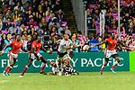 Ian Minjire of Fiji (C) passes the ball during the HSBC Hong Kong Sevens 2018 match between Fiji and Kenya on 08 April 2018, in Hong Kong, Hong Kong. Photo by Marcio Rodrigo Machado / Power Sport Images