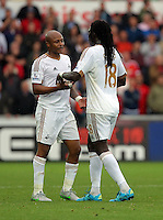 Pictured L-R: Andre Ayew greeted by team mate Bafetimbi Gomis of Swansea Sunday 30 August 2015<br /> Re: Premier League, Swansea v Manchester United at the Liberty Stadium, Swansea, UK