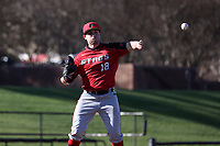 GREENSBORO, NC - FEBRUARY 25: Michael Sansone #18 of Fairfield University makes a pick-off throw to first base during a game between Fairfield and UNC Greensboro at UNCG Baseball Stadium on February 25, 2020 in Greensboro, North Carolina.