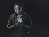 """Mrs Ma holds a picture of her son Ma Purei, 3 and half years old, who was stolen  March 22nd 2004. The message reads """"Papa and Mama are hoping that you will come home soon."""" Mrs Ha and Mrs Ma is one of thousands of migrant mothers whose children have been stolen and sold to rich families desperate for a boy. Families are limited to a single child under the China's ruthless One Child Policy...PHOTO BY SINOPIX"""
