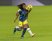 ORLANDO, FL - JANUARY 22: Daniela Arias #3 protects the ball during a game between Colombia and USWNT at Exploria stadium on January 22, 2021 in Orlando, Florida.