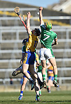 John Conlon of  Clare  in action against Dan Morrissey of  Limerick during their NHL quarter final at the Gaelic Grounds. Photograph by John Kelly.