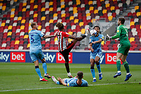 17th October 2020; Brentford Community Stadium, London, England; English Football League Championship Football, Brentford FC versus Coventry City; Ivan Toney of Brentford attempts to chip the ball over Goalkeeper Marko Marosi of Coventry City