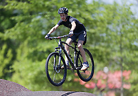 Blake Collier, 14, of Conway  rides off of a ramp, Friday, April 30, 2021 at the Railyard bike park in Rogers. Check out nwaonline.com/210501Daily/ for today's photo gallery. <br /> (NWA Democrat-Gazette/Charlie Kaijo)