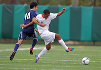 HYATTSVILLE, MD - OCTOBER 26, 2012:  Jonathan Ware (6) of DeMatha Catholic High School is held by Arjan Ganji (10) of St. Albans during a match at Heurich Field in Hyattsville, MD. on October 26. DeMatha won 2-0.