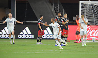 WASHINGTON, DC - AUGUST 25: Teal Bunbury #10 of New England Revolution celebrates his score with teammate Henry Kessler #4 during a game between New England Revolution and D.C. United at Audi Field on August 25, 2020 in Washington, DC.