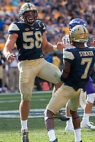 Pitt linebacker Quintin Wirginis (58) celebrates a tackle. The Pitt Panthers football team defeated the Albany Great Danes 33-7 on September 01, 2018 at Heinz Field, Pittsburgh, Pennsylvania.