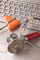 Stethoscope on laptop