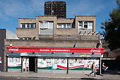 Supermarket and burnt-out shell of Grenfell Tower, Kensington & Chelsea, London.