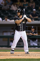 George Kottaras (20) of the Charlotte Knights at bat against the Louisville Bats at BB&T BallPark on May 12, 2015 in Charlotte, North Carolina.  The Knights defeated the Bats 4-0.  (Brian Westerholt/Four Seam Images)