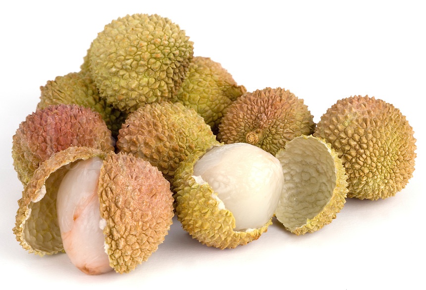 Lychee Nuts open and whole on a white backdro
