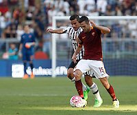 Calcio, Serie A: Roma vs Juventus. Roma, stadio Olimpico, 30 agosto 2015.<br /> Roma's Miralem Pjanic, right, is challenged by Juventus' Simone Padoin during the Italian Serie A football match between Roma and Juventus at Rome's Olympic stadium, 30 August 2015.<br /> UPDATE IMAGES PRESS/Isabella Bonotto