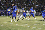 Quarterback rolls right and throws, avoiding rushing lineman.