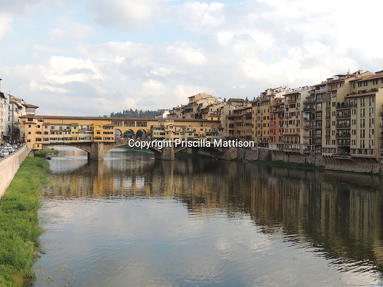 Florence, Italy - October 3, 2012:  The Ponte Vecchio spans the Arno River.