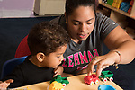 Education Preschool Phase-in First Days of School toddler 2s female teacher playing with boy and toy vehicles at start of day