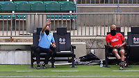 CARY, NC - AUGUST 01: Tommy Soehn and Khano Smith watch from the technical area during a game between Birmingham Legion FC and North Carolina FC at Sahlen's Stadium at WakeMed Soccer Park on August 01, 2020 in Cary, North Carolina.
