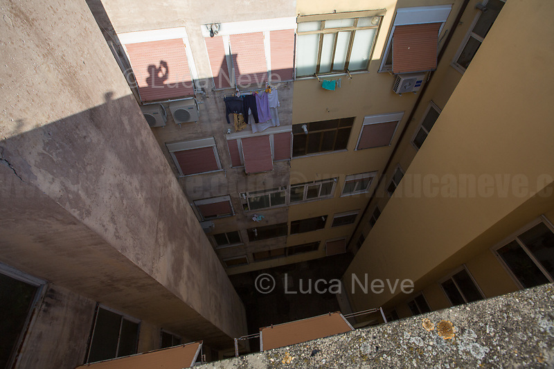 Rome, 16/03/2020. Rome's Olympic Village district under the Italian Government lockdown for the Outbreak of the Coronavirus SARS-CoV-2 - COVID-19. On the 22nd March, the Italian PM Giuseppe Conte signed a new Decree Law which suspends non-essential industry productions and contains the list of allowed working activities, which includes Pharmaceutical & food Industry, oil & gas extraction, clothes & fabric, tobacco, transports, postal & banking services (timetables & number of agencies reduced), delivery, security, hotels, communication & info services, architecture & engineer, IT manufacturers & shops, call centers, domestic personnel (1.).<br /> Updates: Italy: 22.03.20, 6:00PM: 46.638 positive cases; 7.024 recovered; 5.476 died.<br /> <br /> The Rome's Olympic Village (1957-1960) was designed by: V. Cafiero, A. Libera, A. Luccichenti, V. Monaco, L. Moretti. «Built to host the approximately 8,000 athletes involved in the 1960 Olympic Games, Rome's Olympic Village is a residential complex located between Via Flaminia, the slopes of Villa Glori and Monti Parioli. It was converted into public housing [6500 inhabitants, ndr] at the end of the sporting event. The intervention is an example of organic settlement, characterized by a strong formal homogeneity, consistent with the Modern Movement's principles of urbanism. The different architectural structures are made uniform by the use of some common elements: the pilotis, ribbon windows, concrete stringcourses, and yellow brick curtain covering. At the center of the neighborhood, the Corso Francia viaduct - a road bridge about one kilometer long - was built by Pier Luigi Nervi […]» (2.).<br /> <br /> Info about COVID-19 in Italy: http://bit.do/fzRVu (ITA) - http://bit.do/fzRV5 (ENG)<br /> 1. March 22nd Decree Law http://bit.do/fFwJn (ITA)<br /> 2. (Atlantearchitetture.beniculturali.it MiBACT, ITA - ENG) http://bit.do/fFw3H<br /> 12.03.20 Rome's Lockdown for the Outbreak of the Coronavirus SARS-CoV-2 - COVID-19 http://bit