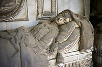 Picture and image of the stone sculpture of a dead women lying at rest in a realistic style. The Pignone Avanzini tomb sculpted by G Benetti 1867. Section D no 4, the monumental tombs of the Staglieno Monumental Cemetery, Genoa, Italy