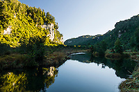 Reflections of vertical limestone cliffs in Pororari River in Punakaiki, Paparoa National Park, Buller Region, West Coast, New Zealand