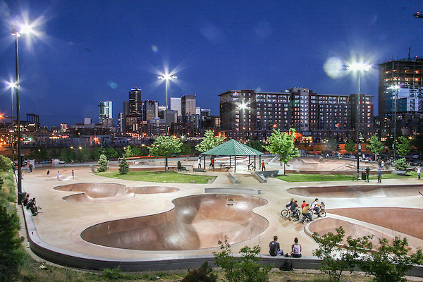 Denver Skatepark and skyline at night, Denver, Colorado,