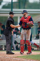 GCL Red Sox catcher Jacob Herbert (12) shakes hands with umpire Matt Blackborow after a Gulf Coast League game against the GCL Pirates on August 1, 2019 at Pirate City in Bradenton, Florida.  GCL Red Sox defeated the GCL Pirates 11-3.  (Mike Janes/Four Seam Images)