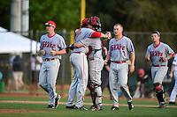Ball State Cardinals pitcher Trevor Henderson (19) and catcher Jarett Rindfleisch embrace as Scott Baker (41) and Scott Tyler (7) join the celebration after a win against the Dartmouth Big Green on March 7, 2015 at North Charlotte Regional Park in Port Charlotte, Florida.  Ball State defeated Dartmouth 7-4.  (Mike Janes/Four Seam Images)