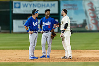 Rancho Cucamonga Quakes infielders Brandon Montgomery (12) and Jeter Downs (15) talk to Tim Susnara (6) during a California League game against the Visalia Rawhide on April 8, 2019 in Visalia, California. Rancho Cucamonga defeated Visalia 4-1. (Zachary Lucy/Four Seam Images)