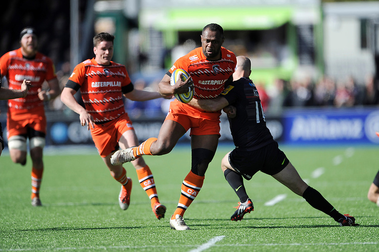 Vereniki Goneva of Leicester Tigers is tackled by Charlie Hodgson of Saracens as Freddie Burns of Leicester Tigers supports during the Aviva Premiership Rugby match between Saracens and Leicester Tigers at Allianz Park on Saturday 11th April 2015 (Photo by Rob Munro)