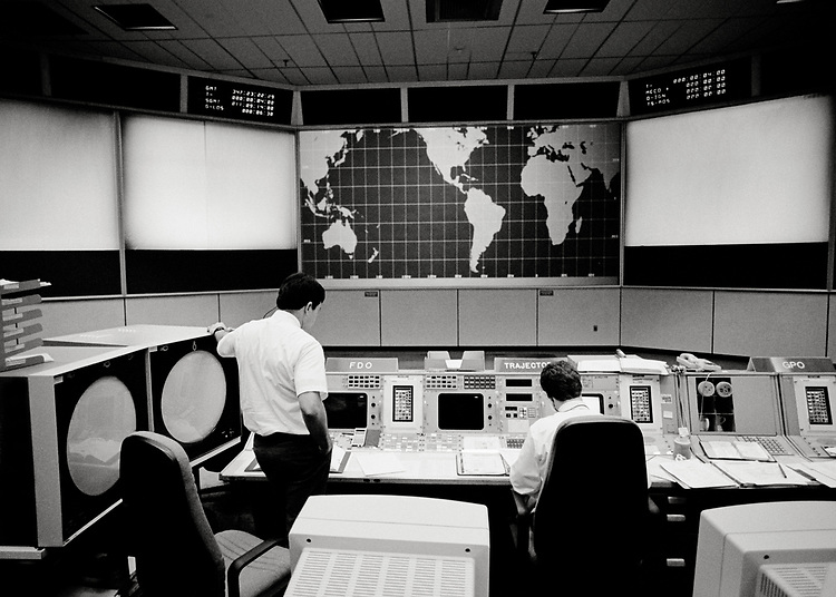 Image copyright John Angerson. <br /> STS-72 mission training.<br /> The White Flight Control Center that was used for all Space Shuttle operations was arranged in five separate departments: 1. Orbital guidance and orbital changes. 2. Propulsion system. 3.Computer systems. 4.Communications systems. 5. Public Affairs Officer, the live 'voice' of Mission control. <br /> Johnson Space Center, Houston, Texas.