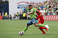 SEATTLE, WA - NOVEMBER 10: Roman Torres #29 of the Seattle Sounders FC clears the ball during a game between Toronto FC and Seattle Sounders FC at CenturyLink Field on November 10, 2019 in Seattle, Washington.