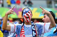 A USA supporter with a painted face celebrates at full time following their progression to the next round