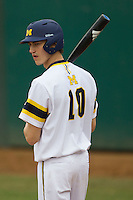 Michigan Wolverines outfielder Jackson Lamb (10) during the NCAA baseball game against the Washington Huskies on February 16, 2014 at Bobcat Ballpark in San Marcos, Texas. The game went eight innings, before travel curfew ended the contest in a 7-7 tie. (Andrew Woolley/Four Seam Images)