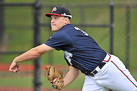 Pitcher Corbin Clouse (36) of the Danville Braves warms up before in a game against the Johnson City Cardinals on Friday, July 1, 2016, at Legion Field at Dan Daniel Memorial Park in Danville, Virginia. Johnson City won, 1-0. (Tom Priddy/Four Seam Images)