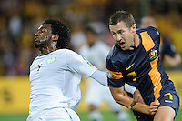 Kamel AL MOUSA (7) of Saudi Arabia and Brett EMERTON (7) of Australia compete for the ball during the FIFA 2014 World Cup Group D Asian Qualifier match between Australia and Saudi Arabia at AAMI Park in Melbourne, Australia...This image is not for sale on this web site. Please contact Southcreek Global Media for licensing:.Toll Free: 1.800.934.5030.Canada: 701 Rossland Rd. East, Suite 315, Whitby, Ontario, Canada, L1N 9K3.USA: 10792 Baron Dr, Parma OH, USA 44130.Web: http://southcreekglobal.net/ and http://southcreekglobal.com/