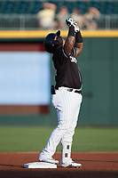 Yermin Mercedes (24) of the Charlotte Knights points to the sky as he stands on second base during the game against the Gwinnett Stripers at Truist Field on July 15, 2021 in Charlotte, North Carolina. (Brian Westerholt/Four Seam Images)